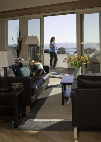 Woman Standing on Balcony on SF Bay